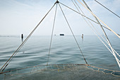 View of a stilt house, in the foreground a fishing net, port of Pellestrina, Venetian lagoon, Veneto, Italy, Europe