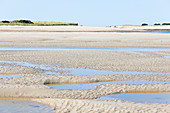 The beach at low tide in front of Portbail, Cotentin Peninsula, Normandy, France
