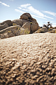 View over a rock to another rock formation in the Jumbo Rocks in Joshua Tree Park, California, USA.