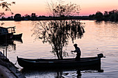 A fisherman in the Danube Delta casts at dusk, Mila 23, Tulcea, Romania.