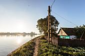Fisherman's house in the Danube Delta, dusk in April, Mila 23, Tulcea, Romania.