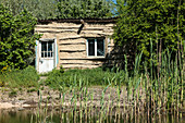 Danube Delta in April, mud hut on the banks of Lacul Merhei, Mila 23, Tulcea, Romania.