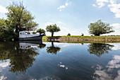 Boat in the Danube Delta in April, Canalul Stipoc, Mila 23, Tulcea, Romania.