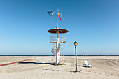 Black Sea coast at the mouth of the Danube / Danube Delta, observation tower, lantern and lounger in the sand, Sulina, Tulcea, Romania.