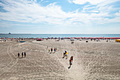 Black Sea coast: bathing beach with bathers, loungers and parasols, Eforie Nord, Constanta County, Romania.