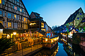 Old town decorated for Christmas with colorfully illuminated half-timbered houses, Colmar, Alsace, France