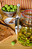 Prepare walnut liqueur yourself, ingredients, homemade with herbs from your own garden