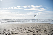 Shower in a deserted beach in winter, Forte die Marmi, Tuscany, Italy