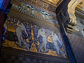 Quartiere Coppeda, Rome, Italy: detail of a building, interior wall decor with gold and blue design in Art Nouveau style