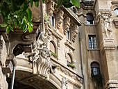 Quartiere Coppeda, Rome, Italy: detail of a sculpture on an archway