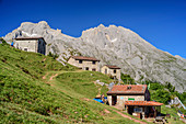 Alpine settlement with Refugio Terenosa, Neveron de Urriello and Pico de Albo in the background, Picos de Europa, Picos de Europa National Park, Cantabrian Mountains, Asturias, Spain