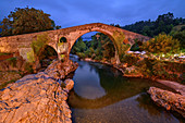 Illuminated bridge in Cangas de Onis, Puente Romano, Roman Bridge, Cangas de Onis, Picos de Europa, Cantabrian Mountains, Asturias, Spain
