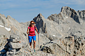 Woman hiking ascends to the Torre de los Horcados Rojos, Picos de Europa, Picos de Europa National Park, Cantabrian Mountains, Cantabria, Spain