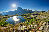 Deep view of Lac Roumassot and Pic du Midi d´Ossau, Lac Roumassot, Pyrenees National Park, Pyrénées-Atlantiques, Pyrenees, France