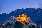 Illuminated Castle of Queyras with Cottian Alps in the background, Queyras, Cottian Alps, Hautes-Alpes, France