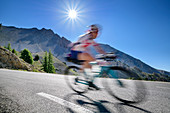 Cyclists out of focus in the descent at Col d´Izoard, Col d´Izoard, Cottian Alps, Hautes-Alpes, France