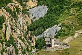 Church and erosion landscape of Cervieres at Col d´Izoard, Col d´Izoard, Cottian Alps, Hautes-Alpes, France