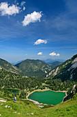 Woman while hiking looks out over Soiernseen, Soiernspitze, Karwendel, Upper Bavaria, Bavaria, Germany