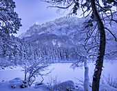 View over the frozen lake to the Eibsee Hotel, Grainau, Upper Bavaria, Bavaria, Germany