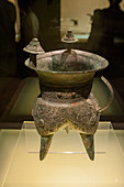 A wine vessel from the 16th to 13th Century BC in the bronze exhibit at the Shanghai Museum, a museum of ancient Chinese art, situated on the Peoples Square in the Huangpu District of Shanghai, China.