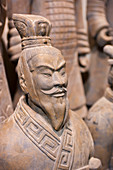 Close-up of a warrior statue in the Terracotta Warriors and Horses Museum, displaying the collection of terracotta sculptures depicting the armies of Qin Shi Huang (259 BC - 210 BC), the first Emperor of China, in Xian, China.