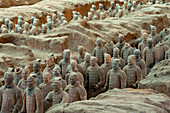 Overview of the Terracotta Army in the Terracotta Warriors and Horses Museum, which is displaying the collection of terracotta sculptures depicting the armies of Qin Shi Huang (259 BC - 210 BC), the first Emperor of China, in Xian, China.