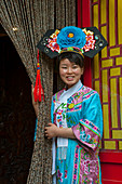A waitress dressed in a historic costume at the Bai Jia Da Yuan Restaurant in Beijing, China.