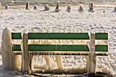 Bench by the Neuchatel lake under snow and ice. From Yverdon-les-Bains, Switzerland