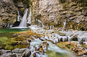 Waterfall of La Tine de Conflens under ice. Switzerland