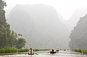 Ngo Dong River, Tam Coc near Ninh Binh, near Hanoi, Vietnam, tourists in rowing boats