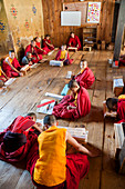 Young monks studying, Chimi Lhakhang Monastery, Pana, Bhutan
