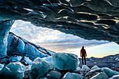 Glacial Ice Cave, Svinafellsjokull glacier, Skaftafell National Park, Iceland. Model Released.
