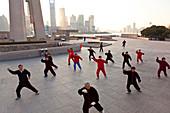Tai Chi exercises, early morning, The Bund, Shanghai, China