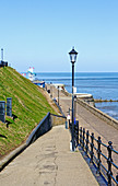 A view of the access slope to the promenade at the North Norfolk seaside resort of Cromer, Norfolk, England, United Kingdom.
