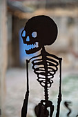 A metal silhouetted skeleton on display in an art exhibit in Oaxaca City, Mexico.