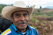 Portrait of a farmer in a field near the Mixtec village of San Juan Contreras near Oaxaca, Mexico.