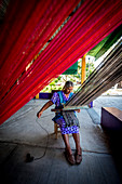 Indigenous women working handcrafted yarn in the state of Oaxaca in Mexico