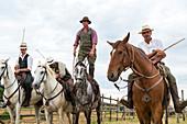 Tuscany, Italy - May 25, 2014: Men riding horses in Tuscany