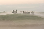Chapel in morning mist in Tuscany Italy