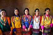 Group of young Bhutanese women in traditional dress, at a festival, Gangtey Dzong or monastery, Phobjikha Valley, Bhutan