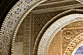 Ornate pattern on the arches in the Alhambra, Granada, Andalusia, Spain
