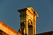 Bell tower of a church lit by warm sunlight, Seville, Andalusia, Spain