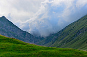A storm cloud front flows over the Gitschenen in the Alps, near Isenthal, Switzerland