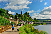Cyclists with full luggage and dog on the cycle path along the Saar, view of Saarburg, Germany