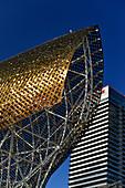 The golden roof of El Pez Dorado against a blue sky, Barcelona, Catalonia, Spain