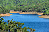 A reservoir surrounded by hills and forest, near Marmelete, Algarve, Portugal