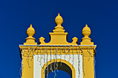 View of the yellow and white church with fairy lights, Luz, Algarve, Portugal