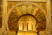 Golden ornate arch in the chamber of the Mosque-Cathedral, Cordoba, Andalusia, Spain
