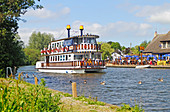 A view of the Southern Comfort pleasure boat making way on the River Bure on the Norfolk Broads at Horning, Norfolk, England, United Kingdom.