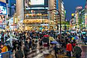 Pedestrians with umbrellas Shibuya Crossing, one of the busiest crosswalks in the world, Tokyo, Japan